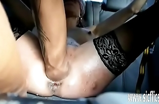 Punch fisting her ass and pussy in bondage