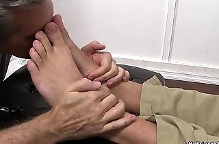 Perverted guy massages hunk feet and licks them real good