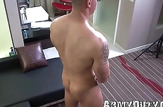 Dazzling inked army jock strokes his thick load of shit real hard