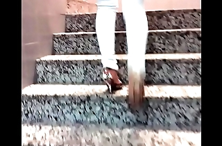 Candid woman in high heels climbing stairs
