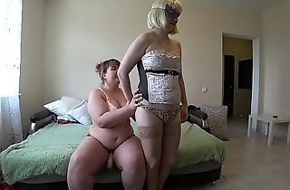 A girlfriend with a strapon fucks a pregnant lesbian, shaking a juicy ass and shaking natural tits with big nipples.