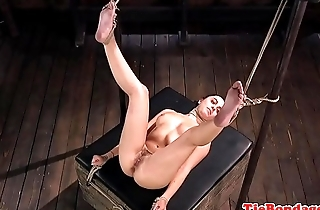 BDSM babe with glasses gets feet tormented